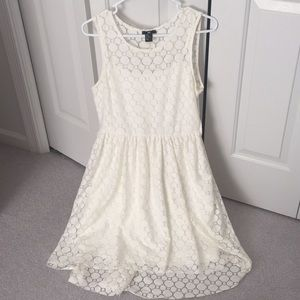 Crocheted white lace dress